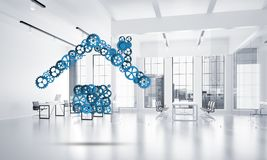 Real estate or construction idea presented by home icon on white office background. Conceptual background image with house sign made of connected gears. 3d Stock Photography