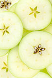 Conceptual background pattern and texture of sliced apples Royalty Free Stock Images