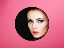 Conceptual beauty portrait of beautiful young woman. Cosmetic Eyeshadows. Fashion photo Stock Photography