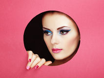 Conceptual beauty portrait of beautiful young woman. Perfect Manicure.  Cosmetic Eyeshadows. Fashion photo Stock Image
