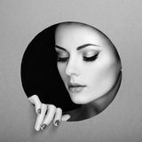 Conceptual beauty portrait of beautiful young woman. Perfect Manicure.  Cosmetic Eyeshadows. Fashion photo. Black and white Stock Photography