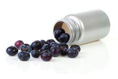 Conceptual black currant berries as pills Stock Photo