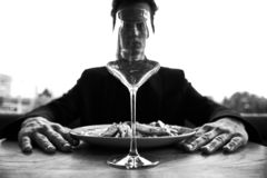 Conceptual black and white photography. Man throuth the glass wine. Blurred background. Mankind stock photos