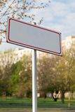 Conceptual blank sign with red tin frame in the city stock photo