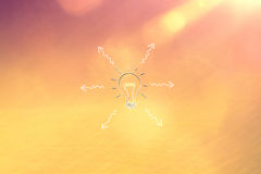 Conceptual blurred bokeh lightbulb with arrows Stock Images