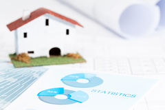 Conceptual building industry. Conceptual housing industry with statistical documents royalty free stock photography