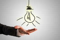 Conceptual Bulb Drawing Over Businessman Hand Royalty Free Stock Photography