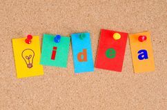 Conceptual Bulletin Board with The Word Idea on Colourful Paper Stock Photography