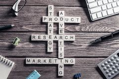 Conceptual business keywords on table with elements of game maki Stock Photography