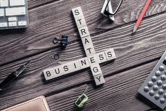 Conceptual business keywords on table with elements of game maki Royalty Free Stock Photography