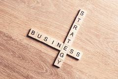 Conceptual business keywords on table with elements of game maki Stock Image