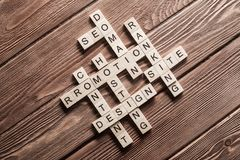 Conceptual business keywords on table with elements of game making crossword Stock Images