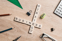 Conceptual business keywords on table with elements of game making crossword Stock Photo