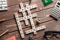 Conceptual business keywords on table with elements of game making crossword Royalty Free Stock Photo