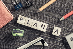 Conceptual business keywords on table with elements of game making words plan a Royalty Free Stock Photography