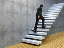 Conceptual business man climbing a stair Royalty Free Stock Photo