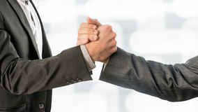Conceptual Business Partners Gripping their Hands Royalty Free Stock Images