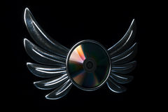 Conceptual cd disk emblem with metallic wings 3d render version Royalty Free Stock Image