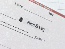 Conceptual check for an arm and leg Royalty Free Stock Images