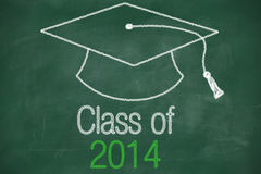 Conceptual Class of 2014 statement. Written on black chalkboard and graduation cap Stock Image