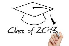 Conceptual Class of 2013 statement. Written on whiteboard and graduation cap Stock Image