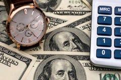 Conceptual clock, calculator  dollar bills. Conceptual clock, calculator on the background of dollar bills Royalty Free Stock Images