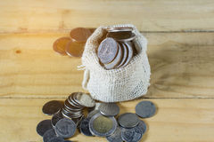 Conceptual coin overflow from hemp sack Stock Images