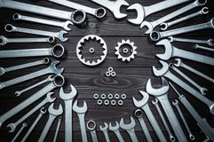 Concept composition of spanners and skull or robot stock images