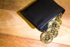 Conceptual cryptocurrency bitcoin with wallet on table. Conceptual cryptocurrency bitcoin with wallet on wooden table Stock Images