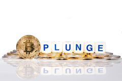Conceptual cryptocurrency bitcoin with the word Plunge. On white background Stock Photos