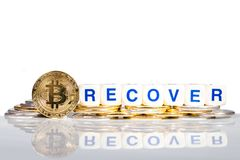 Conceptual cryptocurrency bitcoin with the word Recover. On white background Royalty Free Stock Photography