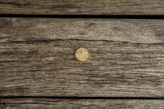 Conceptual of cryptocurrency with one golden bitcoin. On a wooden desk, top view Royalty Free Stock Image