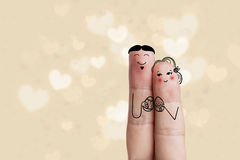 Conceptual easter finger art. Couple are holding Painted eggs. Stock Image. Creative and funny love series. Painted fingers family concept royalty free stock photography