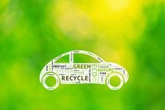 Conceptual eco green car driving with word eco tags Stock Image