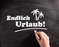 Conceptual Endlich Urlaub Texts on Chalkboard Stock Images