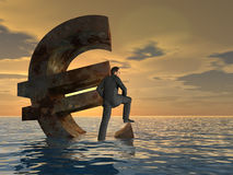 Conceptual Euro crisis with a busines man at sunset. Conceptual Euro crisis with a busines man sinking at sunset sky background Royalty Free Stock Photo