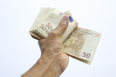 Conceptual euro paper money banknote in human or man hand Stock Image