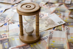 Conceptual euro paper money banknote with a sand glass Stock Images