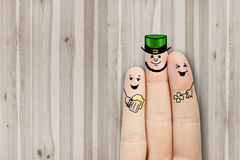 Conceptual finger art. Friends are embracing and drinking beer. Stock Photo