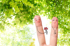 Conceptual finger art of a Happy couple. Man is giving a bouquet. Stock Image Royalty Free Stock Photography
