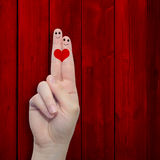 Conceptual fingers in love over red old wood royalty free stock photos