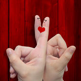 Conceptual fingers in love over red old wood royalty free stock photo