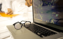 Conceptual focus on glasses businessman working on laptop  sleep Royalty Free Stock Photos