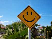 Conceptual funny road sign with a smiley face Stock Image