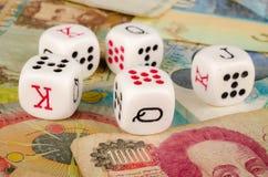 Conceptual gamblig shot. Dice on an assortment of banknotes, a conceptual shot on gambling Royalty Free Stock Photography