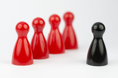 Conceptual game pawns. That depict the concept different Stock Images
