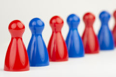 Conceptual game pawns. That visualize the concept chain cooperation Royalty Free Stock Photography