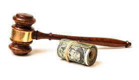 Gavel with money. Abstract still representing the potential monetary expenses involved in a judicial proceeding in the courts. also representing attorney fees Royalty Free Stock Photos