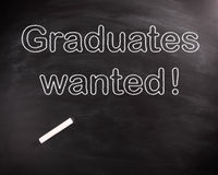 Conceptual Graduates Wanted Texts on Chalkboard Stock Photos