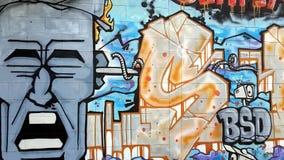 Original graffiti covers concrete walls. Conceptual graffiti on urban walls in Thailand, underground street culture stock footage